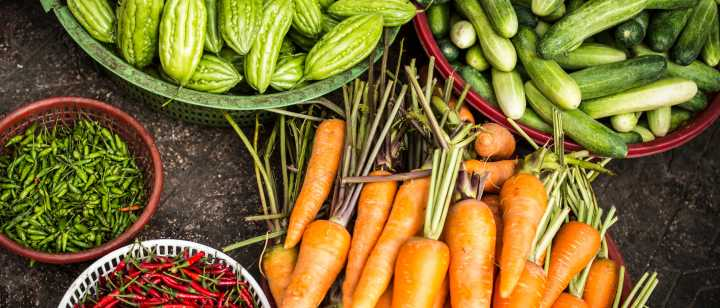 Carrots and baskets of vegetables