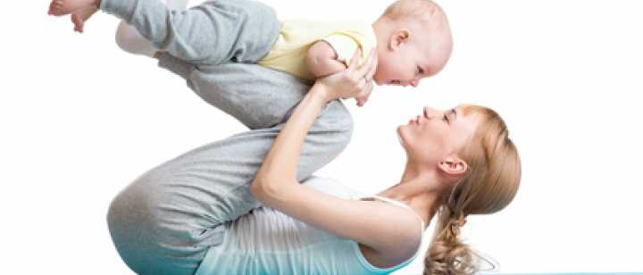 mom exercising on floor mat with baby